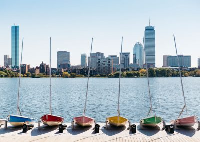 View Of Back Bay Boston, Massachusetts On Charles River With Colorful Sailboats