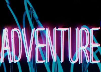 """Neon Says """"adventure"""""""